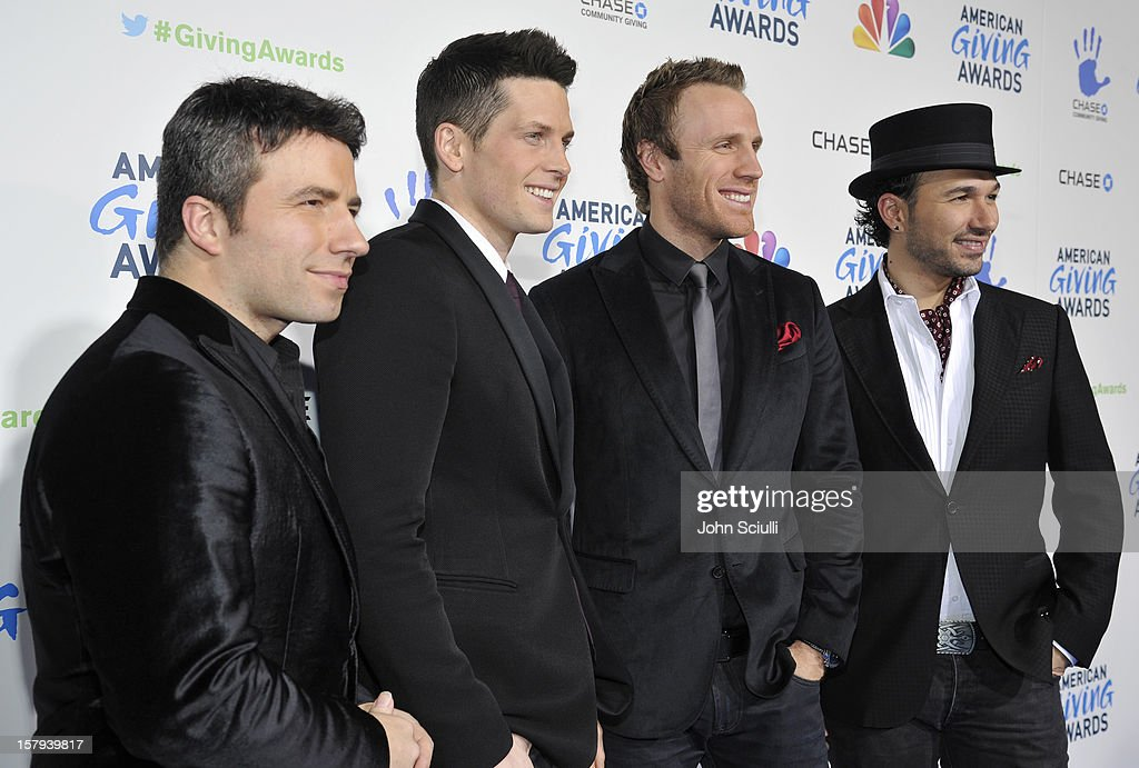 Musicians Remigio Pereira, Victor Micallef, Fraser Walters and Clifton Murray of the Canadian Tenors arrive at the American Giving Awards presented by Chase held at the Pasadena Civic Auditorium on December 7, 2012 in Pasadena, California.