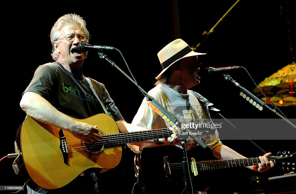 Musicians Richie Furay and Neil Young of Buffalo Springfield performson stage during Bonnaroo 2011 at Which Stage on June 11, 2011 in Manchester, Tennessee.