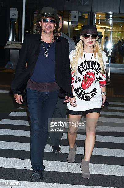 Musicians Richie Sambora and Orianthi Panagaris are seen upon arrival at Narita International Airport on August 11 2014 in Narita Japan
