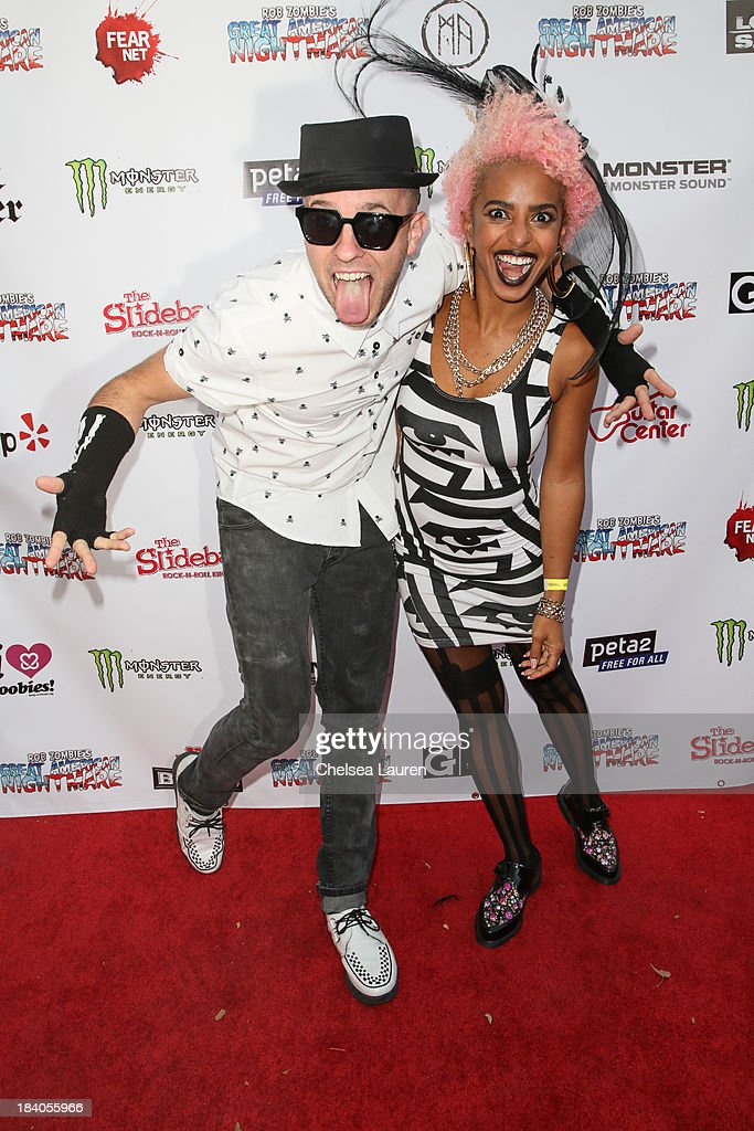 Musicians Ricky Reed (L) and Novena Carmel of Wallpaper. attend Rob Zombie's Great American Nightmare VIP opening night party at Pomona FEARplex on October 10, 2013 in Pomona, California.