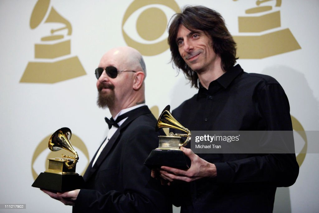 Musicians Rob Halford (L) and Scott Travis of Judas Priest pose in the press room at the 52nd Annual GRAMMY Awards held at Staples Center on January 31, 2010 in Los Angeles, California.