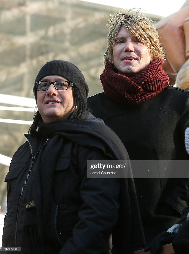 Musicians Robby Takac and Johnny Rzeznik of the Goo Goo Dolls ride The Enchanting World of Lindt Chocolate Float in the 87th Annual Macy's Thanksgiving Day Parade on November 28, 2013 in New York City.
