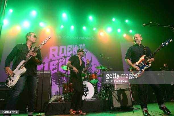 Musicians Robert DeLeo of Stone Temple Pilots Franky Perez and Wayne Kramer of MC5 perform onstage during the second annual Rock for Recovery benefit...