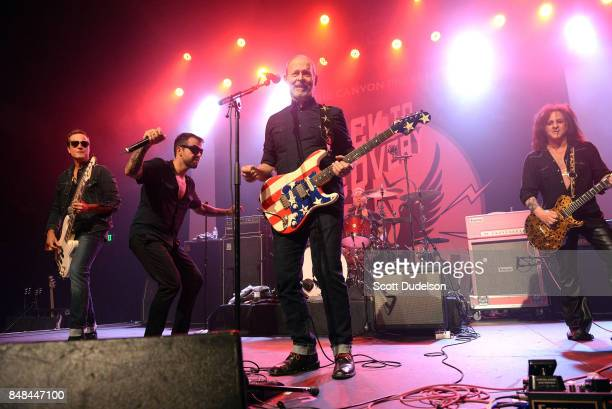 Musicians Robert DeLeo of Stone Temple Pilots Franky Perez Wayne Kramer of MC5 and Steve Stevens of the Billy Idol band perform onstage during the...