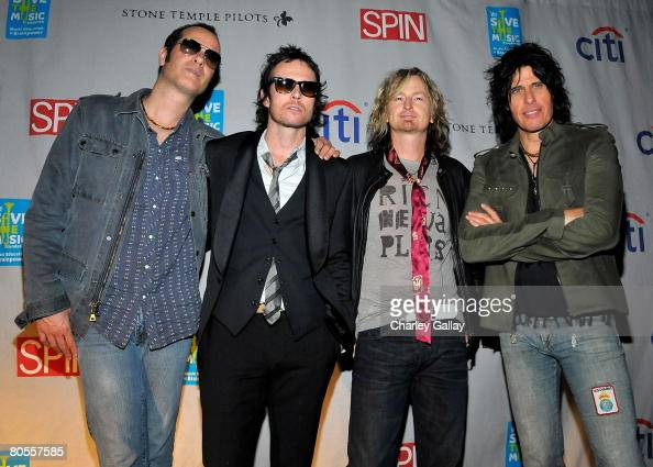 Musicians Robert DeLeo Scott Weiland Eric Kretz and Dean DeLeo pose during the Stone Temple Pilots tour announcement and performance held at a...