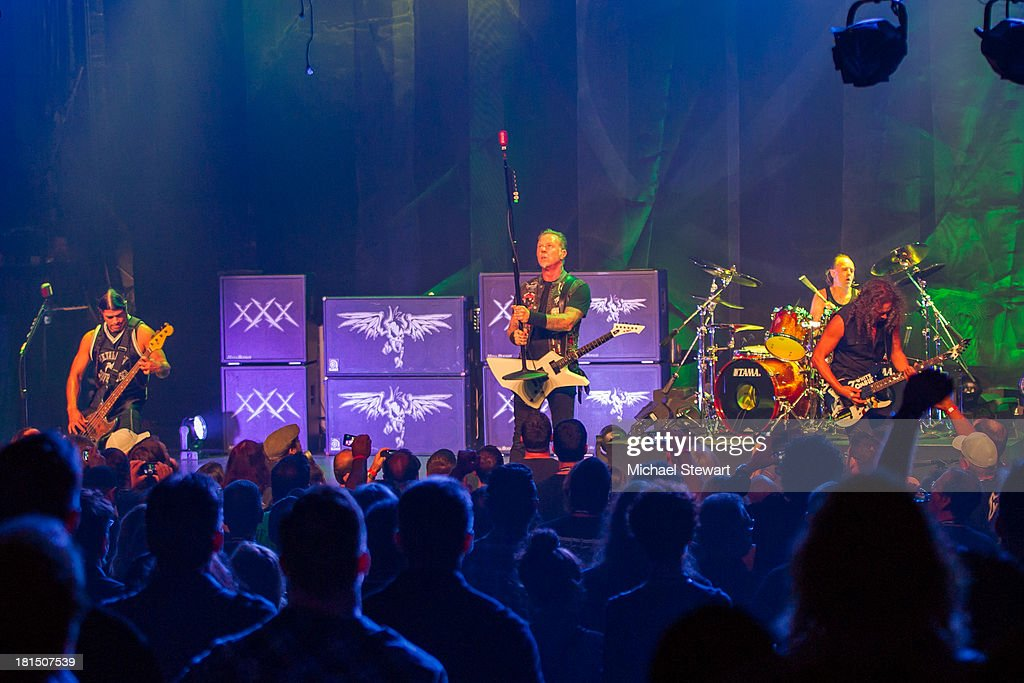 Musicians Robert Trujillo, James Hetfield, Kirk Hammett and Lars Ulrich of Metallica perform at a private exclusive concert for SiriusXM listeners at The Apollo Theater on September 21, 2013 in New York City.