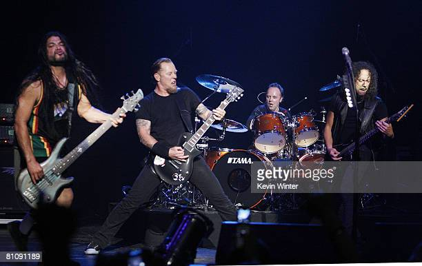Musicians Robert Trujillo James Hetfield Lars Ulrich and Kirk Hammett of Metallica perform at The Silverlake Conservatory of Music Benefit at the...