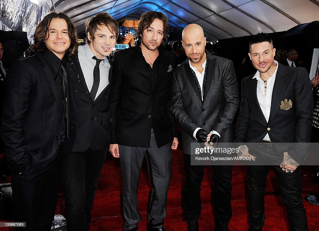 Musicians Robin Diaz, Brian Craaddock, Josh Steely, <a gi-track='captionPersonalityLinkClicked' href=/galleries/search?phrase=Chris+Daughtry&family=editorial&specificpeople=614842 ng-click='$event.stopPropagation()'>Chris Daughtry</a> and Josh Paul of Daughtry arrive at the 2011 American Music Awards held at Nokia Theatre L.A. LIVE on November 20, 2011 in Los Angeles, California.