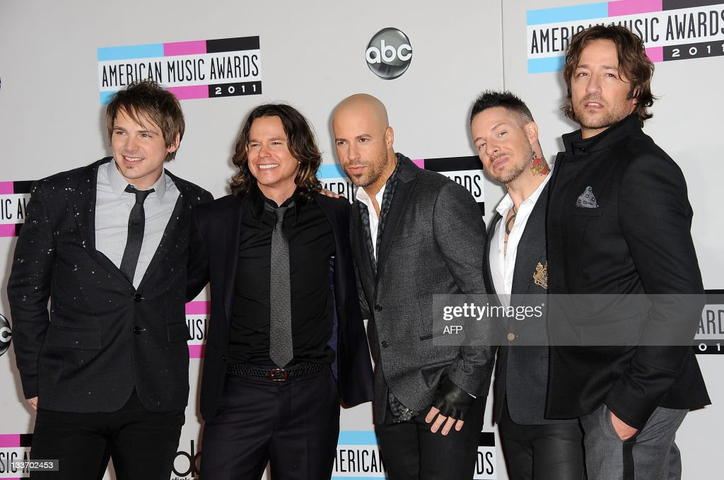 Musicians Robin Diaz, Brian Craddock, Josh Steely, Chris Daughtry and Josh Paul of Daughtry arrives at the American Music Awards, in Los Angeles, California, on November 20, 2011.
