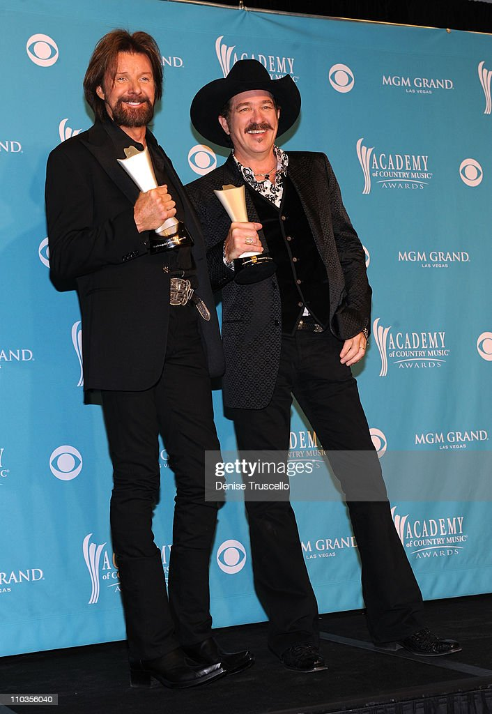 Musicians Ronnie Dunn and Kix Brooks of the band Brooks & Dunn, winners of Top Vocal Duo, pose in the press room during the 45th Annual Academy of Country Music Awards at the MGM Grand Garden Arena on April 18, 2010 in Las Vegas, Nevada.