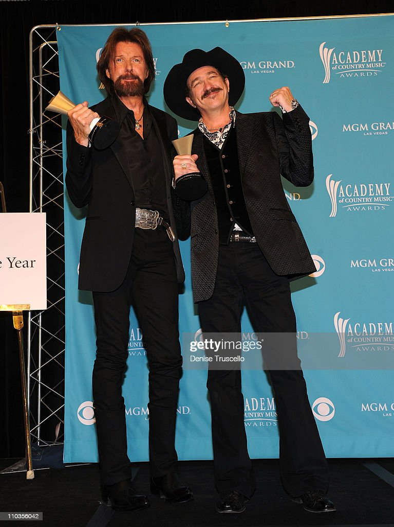 Musicians Ronnie Dunn (L) and Kix Brooks of the band Brooks & Dunn, winners of the Top Vocal Duo Of The Year Award, pose in the press room during the 45th Annual Academy of Country Music Awards at the MGM Grand Garden Arena on April 18, 2010 in Las Vegas, Nevada.