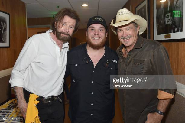 Musicians Ronnie Dunn of Brooks Dunn Luke Combs and Kix Brooks of Brooks Dunn take photos backstage during the 8th annual Darius Friends concert to...