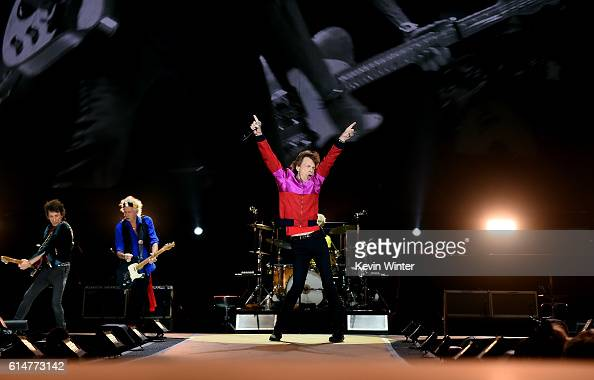 Musicians Ronnie Wood Keith Richards and singer Mick Jagger of The Rolling Stones perform during Desert Trip at the Empire Polo Field on October 14...