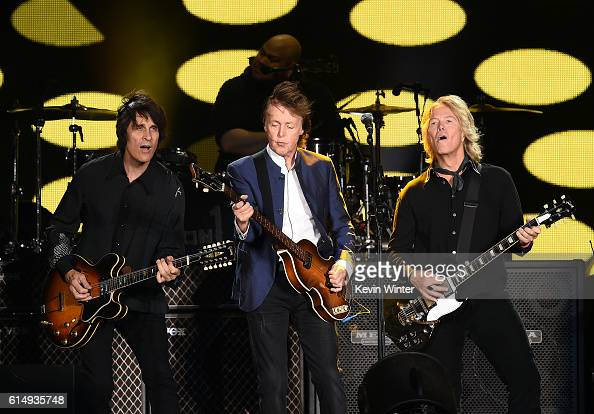 Musicians Rusty Anderson Paul McCartney and Brian Ray perform during Desert Trip at the Empire Polo Field on October 15 2016 in Indio California