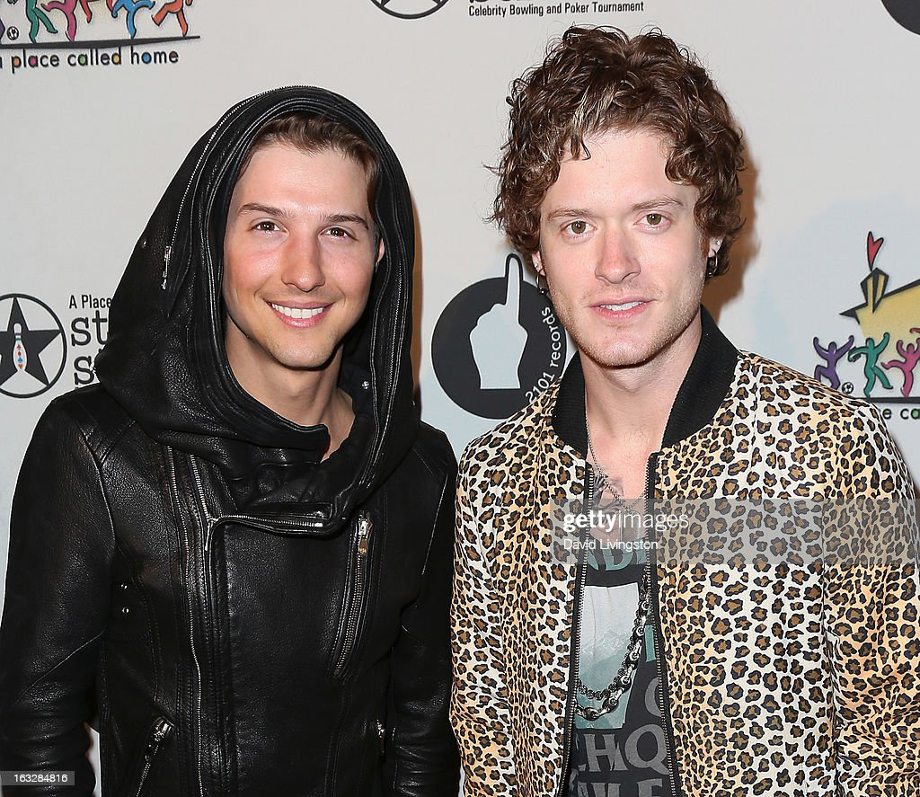 Musicians Ryan Follese (L) and Nash Overstreet of Hot Chelle Rae attend the 7th Annual 'Stars & Strikes' Celebrity Bowling and Poker Tournament benefiting A Place Called Home at PINZ Bowling & Entertainment Center on March 6, 2013 in Studio City, California.