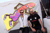 Musicians Ryan Merchant and Sebu Simonian of Capitol Cities pose backstage during the 22nd Annual KROQ Weenie Roast at Verizon Wireless Music Center...