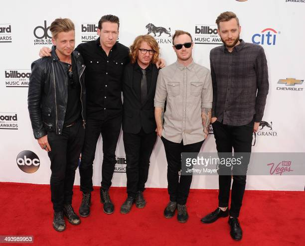 Musicians Ryan Tedder Drew Brown Eddie Fisher Brent Kutzle and Zach Filkins of OneRepublic arrive at the 2014 Billboard Music Awards at the MGM Grand...