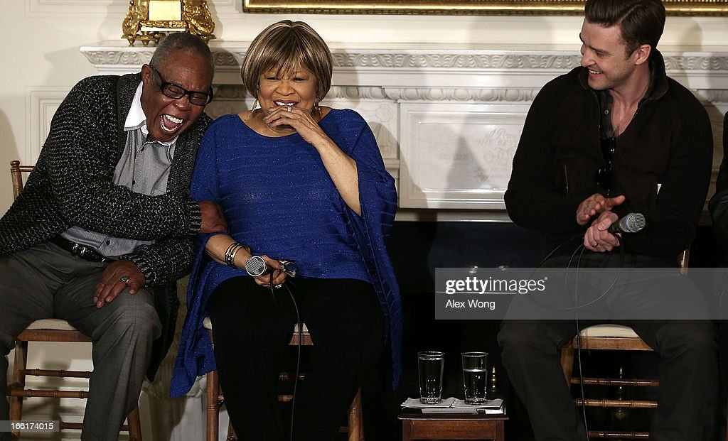 Musicians (L-R) Sam Moore, Mavis Staples, and Justin Timberlake share a moment during an interactive student workshop at the State Dining Room of the White House April 9, 2013 in Washington, DC. The first lady hosted middle and high school students from across the country to take part in the workshop on 'Soulsville,