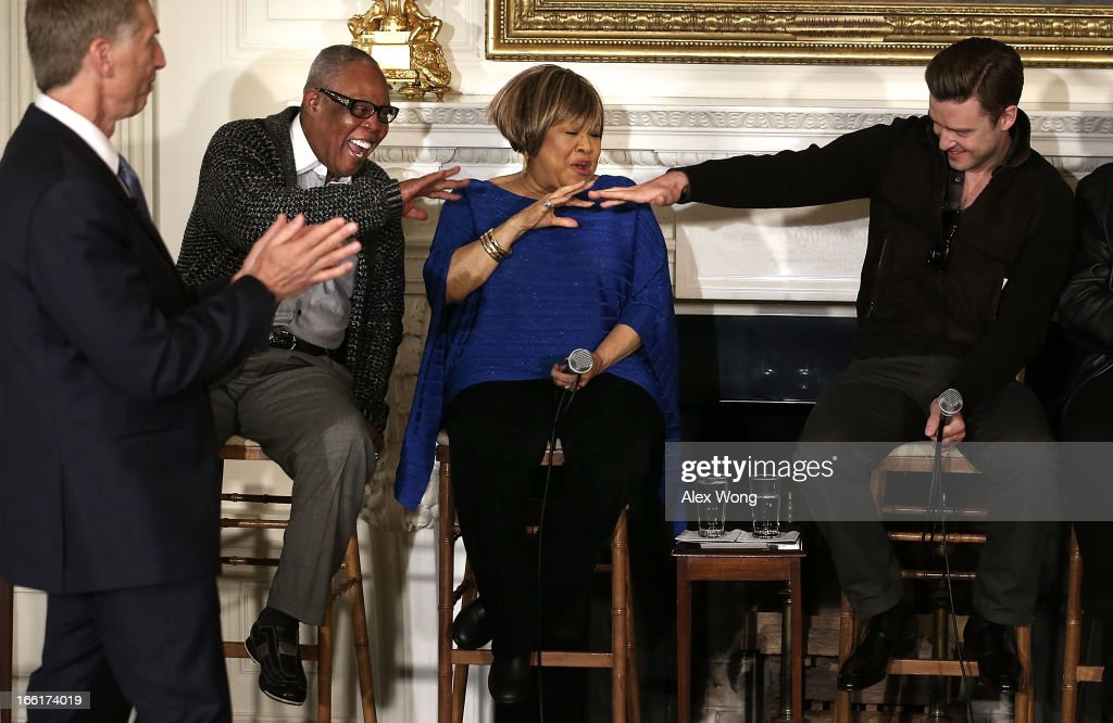 Musicians (2nd L-R) Sam Moore, Mavis Staples, and Justin Timberlake share a moment as Robert Santelli (L), Executive Director of The GRAMMY Museum in Los Angeles, looks on during an interactive student workshop at the State Dining Room of the White House April 9, 2013 in Washington, DC. The first lady hosted middle and high school students from across the country to take part in the workshop on 'Soulsville,