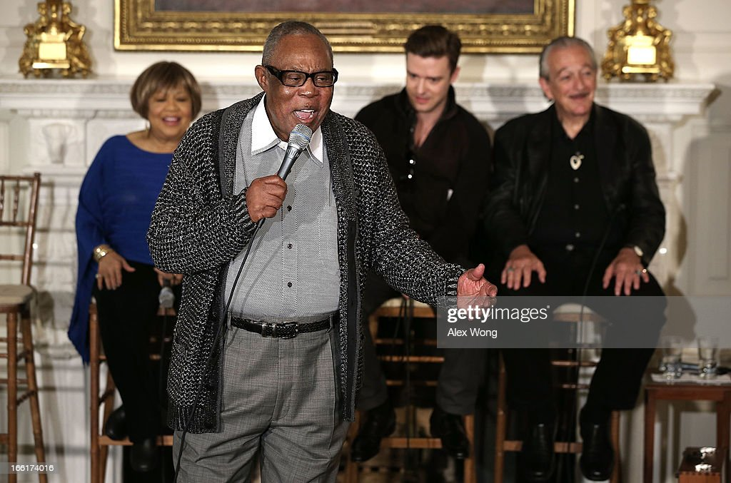 Musicians Sam Moore (2nd L) sings as (L-R) Mavis Staples, Justin Timberlake, and Charlie Musselwhite listen during an interactive student workshop at the State Dining Room of the White House April 9, 2013 in Washington, DC. U.S. first lady Michelle Obama hosted middle and high school students from across the country to take part in the workshop on 'Soulsville,