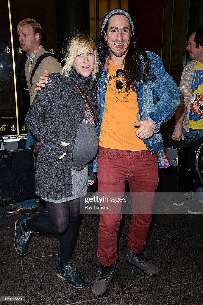 Musicians Sarah Blackwood (L) and Gianni Luminati of Walk Off The Earth leave the Sirius XM Studios on April 18, 2013 in New York City.