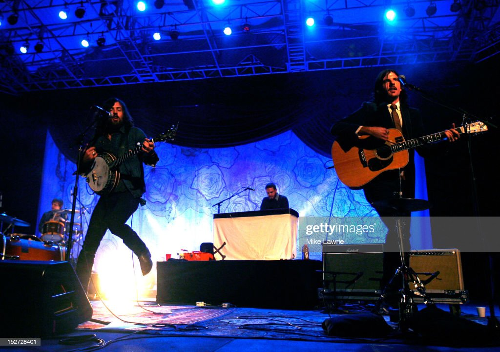 Musicians Scott Avett (L) and Seth Avett of the Avett Brothers performs at SummerStage at Rumsey Playfield, Central Park on September 24, 2012 in New York City.