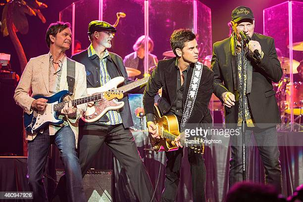 Musicians Scott Totten Randell Kirsch John Stamos and Mike Love of The Beach Boys perform on stage at Pechanga Casino on December 31 2014 in Temecula...