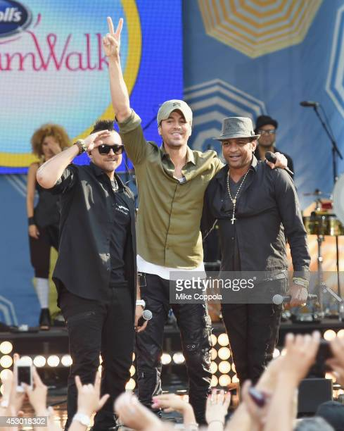 Musicians Sean Paul Enrique Iglesias and Descemer Bueno perform On ABC's 'Good Morning America' at Rumsey Playfield Central Park on August 1 2014 in...