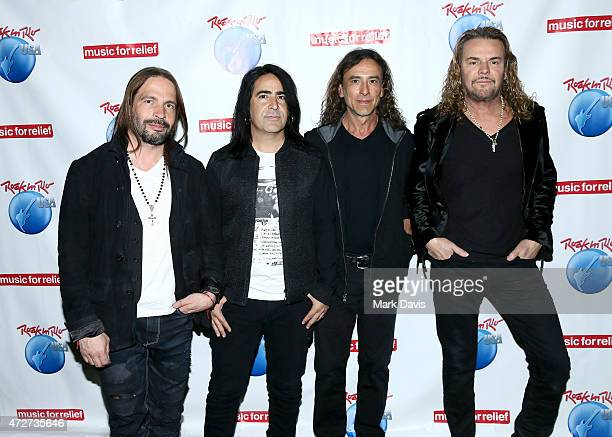 Musicians Sergio Vallin Alex Gonzalez Juan Calleros and Fher Olvera of Mana pose backstage during Rock in Rio USA at the MGM Resorts Festival Grounds...