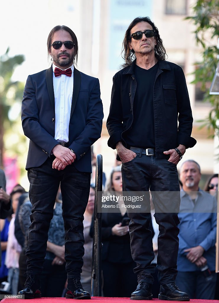Musicians Sergio Vallin and Juan Calleros attend a ceremony honoring Maná with the 2,573rd Star on the Hollywood Walk of Fame on February 10, 2016 in Hollywood, California.