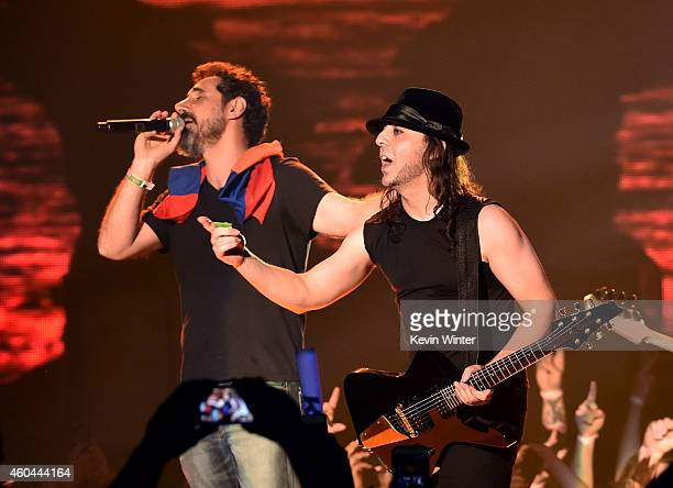 Musicians Serj Tankian and Daron Malakian of System of a Down perform onstage during day one of the 25th annual KROQ Almost Acoustic Christmas at The...