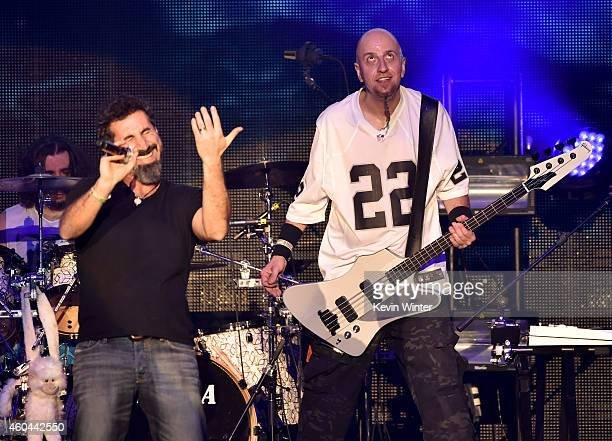 Musicians Serj Tankian and Shavo Odadjian of System of a Down perform onstage during day one of the 25th annual KROQ Almost Acoustic Christmas at The...