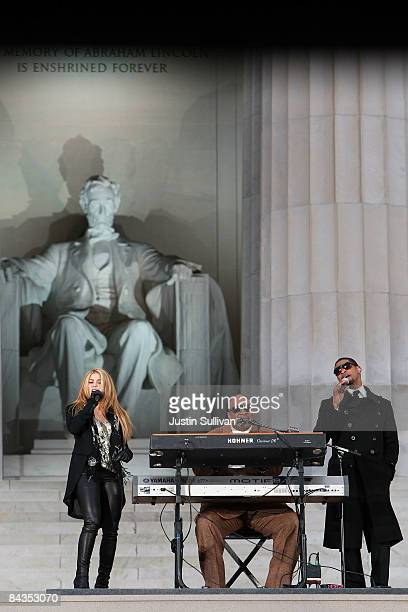 Musicians Shakira Stevie Wonder and Usher perform in front of the Lincoln Memorial during the 'We Are One The Obama Inaugural Celebration At The...