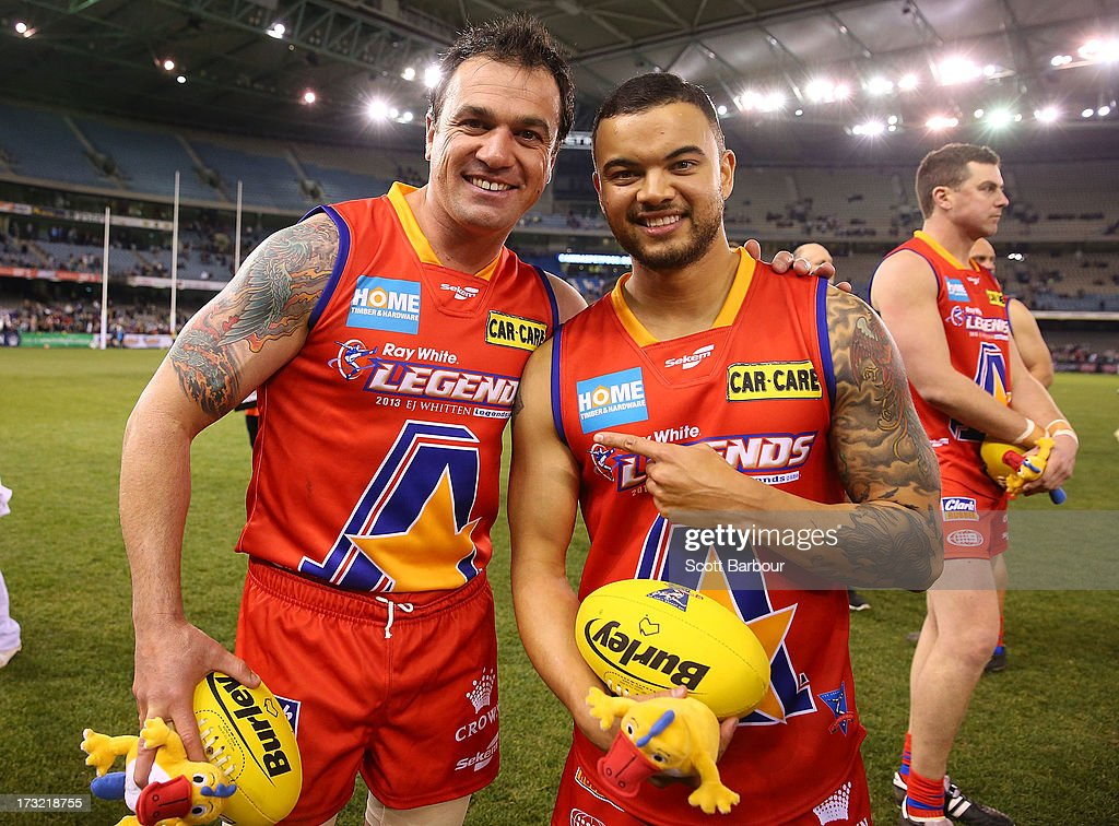 Musicians <a gi-track='captionPersonalityLinkClicked' href=/galleries/search?phrase=Shannon+Noll&family=editorial&specificpeople=206674 ng-click='$event.stopPropagation()'>Shannon Noll</a> and <a gi-track='captionPersonalityLinkClicked' href=/galleries/search?phrase=Guy+Sebastian&family=editorial&specificpeople=202665 ng-click='$event.stopPropagation()'>Guy Sebastian</a> of the All Stars pose after the EJ Whitten Legends AFL game between Victoria and the All Stars at Etihad Stadium on July 10, 2013 in Melbourne, Australia.