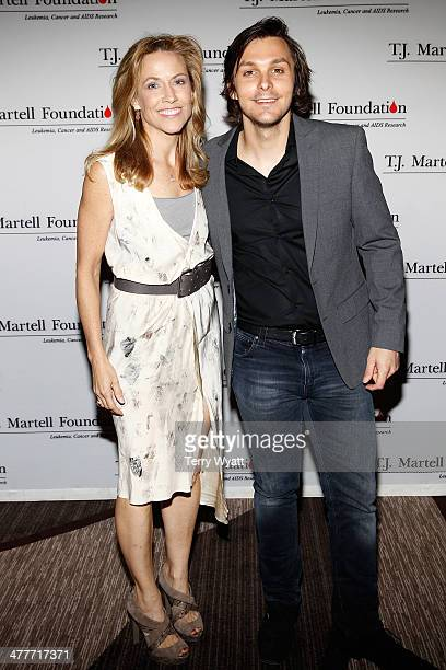 Musicians Sheryl Crow and Charlie Worsham pose backstage during the TJ Martell Foundation Nashville Honors Gala at the Omni Hotel on March 10 2014 in...