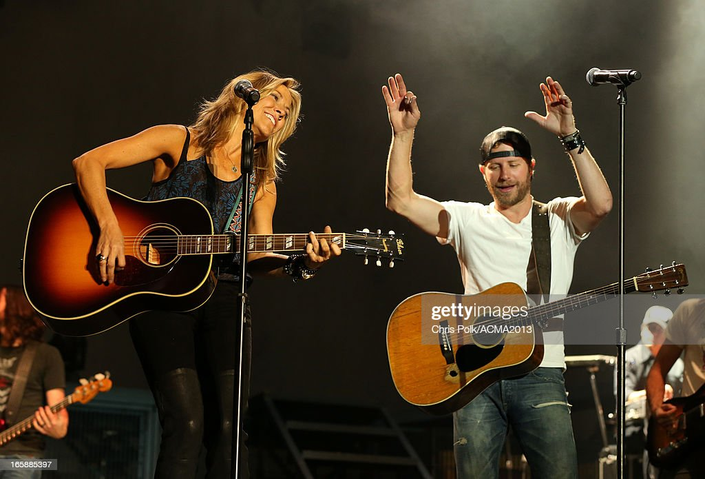 Musicians <a gi-track='captionPersonalityLinkClicked' href=/galleries/search?phrase=Sheryl+Crow&family=editorial&specificpeople=201867 ng-click='$event.stopPropagation()'>Sheryl Crow</a> and <a gi-track='captionPersonalityLinkClicked' href=/galleries/search?phrase=Dierks+Bentley&family=editorial&specificpeople=243007 ng-click='$event.stopPropagation()'>Dierks Bentley</a> perform onstage at the ACM Party For A Cause Festival during the 48th Annual Academy of Country Music Awards at the Orleans Arena on April 6, 2013 in Las Vegas, Nevada.