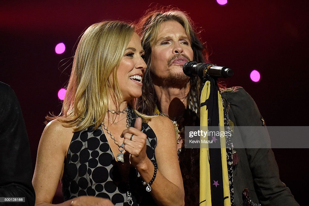 Musicians Sheryl Crow (L) and Steven Tyler perform on stage during the Imagine: John Lennon 75th Birthday Concert at The Theater at Madison Square Garden on December 5, 2015 in New York City.