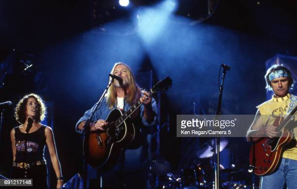 Musicians Sheryl Crow Gregg Allman and Dickey Betts are photographed at the grand opening of the Rock and Roll Hall of Fame Museum on September 7...