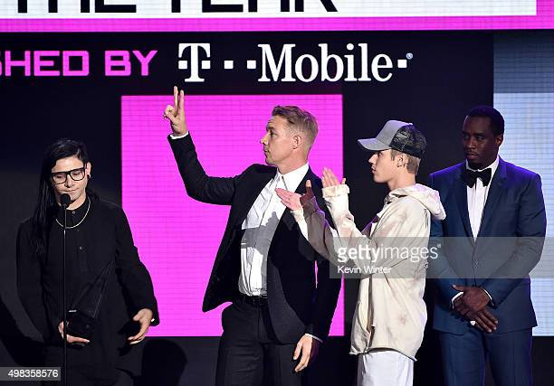 Musicians Skrillex Diplo and Justin Bieber accept Collaboration of the Year award for 'Where Are U Now' from recording artist Sean 'Diddy' Combs...