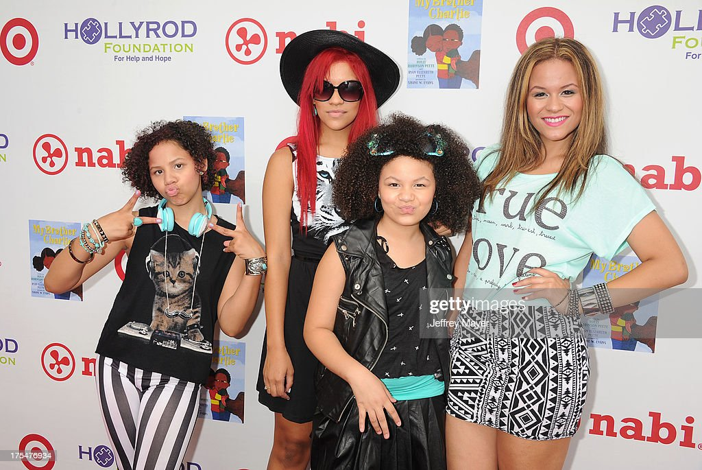 Musicians Sledge Grits Band arrive at HollyRod Foundation's 4th Annual 'My Brother Charlie' Carnival at Culver Studios on August 3, 2013 in Culver City, California.