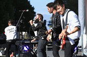 Musicians Spencer Ludwig Sebu Simonian Ryan Merchant and Manuel Quintero of Capital Cities perform on the Marilyn Stage during day 1 of the 2014...