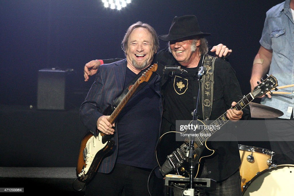 Musicians Stephen Stills (L) and Neil Young perform on stage during the 3rd Light Up the Blues Concert to benefit Autism Speaks held at the Pantages Theatre on April 25, 2015 in Hollywood, California.