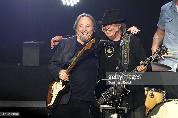 Musicians Stephen Stills and Neil Young perform on stage during the 3rd Light Up the Blues Concert to benefit Autism Speaks held at the Pantages...