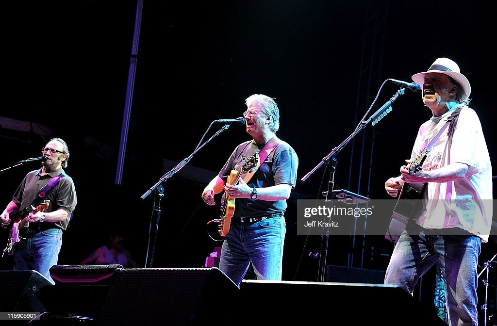 Musicians Stephen Stills, Richie Furay and Neil Young of Buffalo Springfield performs on stage during Bonnaroo 2011 at Which Stage on June 11, 2011 in Manchester, Tennessee.