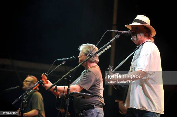 Musicians Stephen Stills Richie Furay and Neil Young of Buffalo Springfield perform on stage during Bonnaroo 2011 at Which Stage on June 11 2011 in...