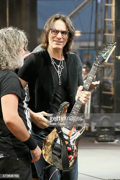 Musicians Steve Vai performs with Paulo Xisto Pinto Jr of Sepultura onstage during Rock in Rio USA at the MGM Resorts Festival Grounds on May 9 2015...