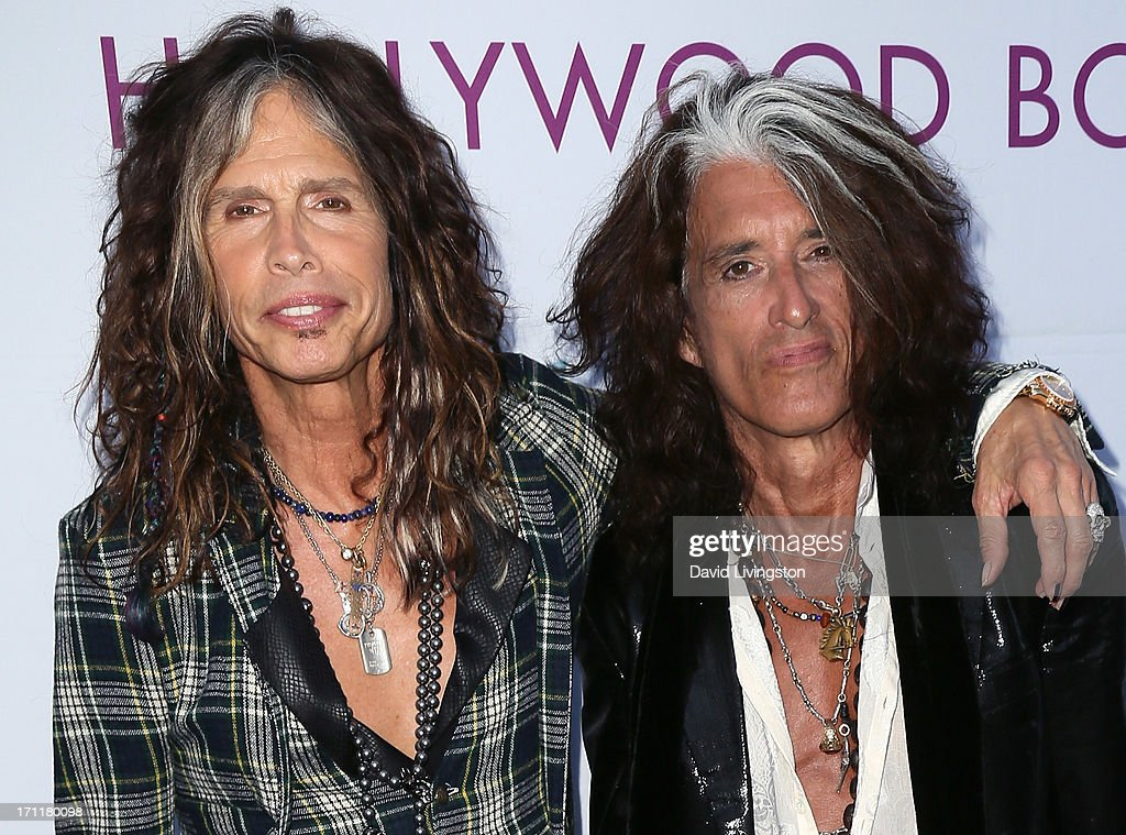 Musicians <a gi-track='captionPersonalityLinkClicked' href=/galleries/search?phrase=Steven+Tyler&family=editorial&specificpeople=202080 ng-click='$event.stopPropagation()'>Steven Tyler</a> (L) and <a gi-track='captionPersonalityLinkClicked' href=/galleries/search?phrase=Joe+Perry+-+Musicien&family=editorial&specificpeople=13600677 ng-click='$event.stopPropagation()'>Joe Perry</a> attend Opening Night at The Hollywood Bowl 2013 at The Hollywood Bowl on June 22, 2013 in Los Angeles, California.