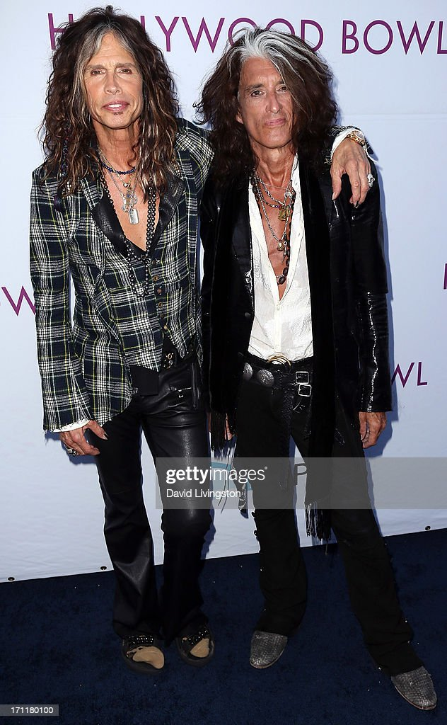 Musicians <a gi-track='captionPersonalityLinkClicked' href=/galleries/search?phrase=Steven+Tyler&family=editorial&specificpeople=202080 ng-click='$event.stopPropagation()'>Steven Tyler</a> (L) and <a gi-track='captionPersonalityLinkClicked' href=/galleries/search?phrase=Joe+Perry+-+M%C3%BAsico&family=editorial&specificpeople=13600677 ng-click='$event.stopPropagation()'>Joe Perry</a> attend Opening Night at The Hollywood Bowl 2013 at The Hollywood Bowl on June 22, 2013 in Los Angeles, California.