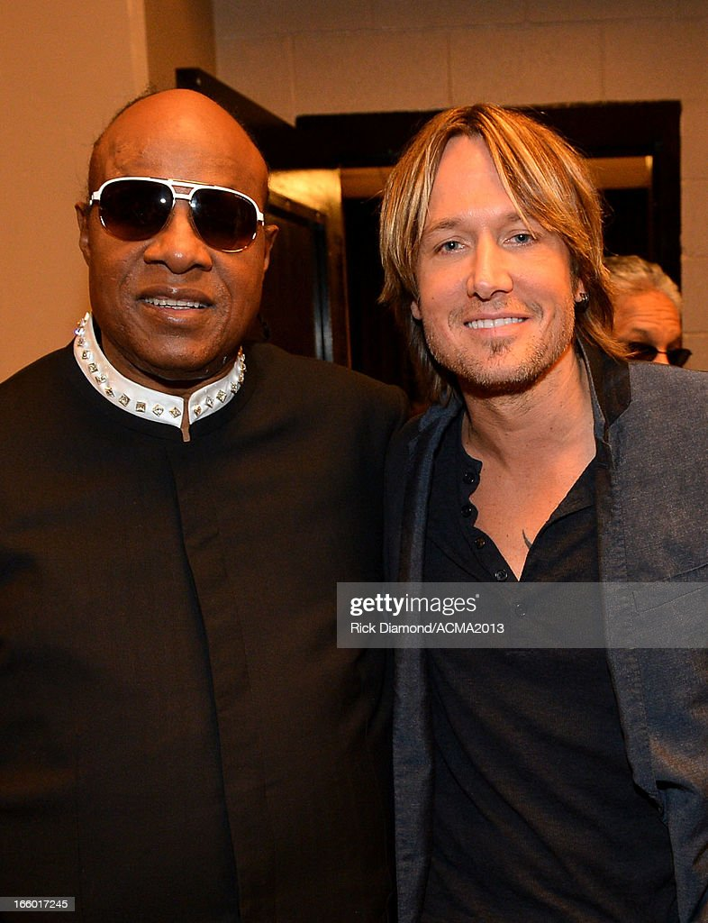 Musicians Stevie Wonder and Keith Urban attend the 48th Annual Academy of Country Music Awards at the MGM Grand Garden Arena on April 7, 2013 in Las Vegas, Nevada.