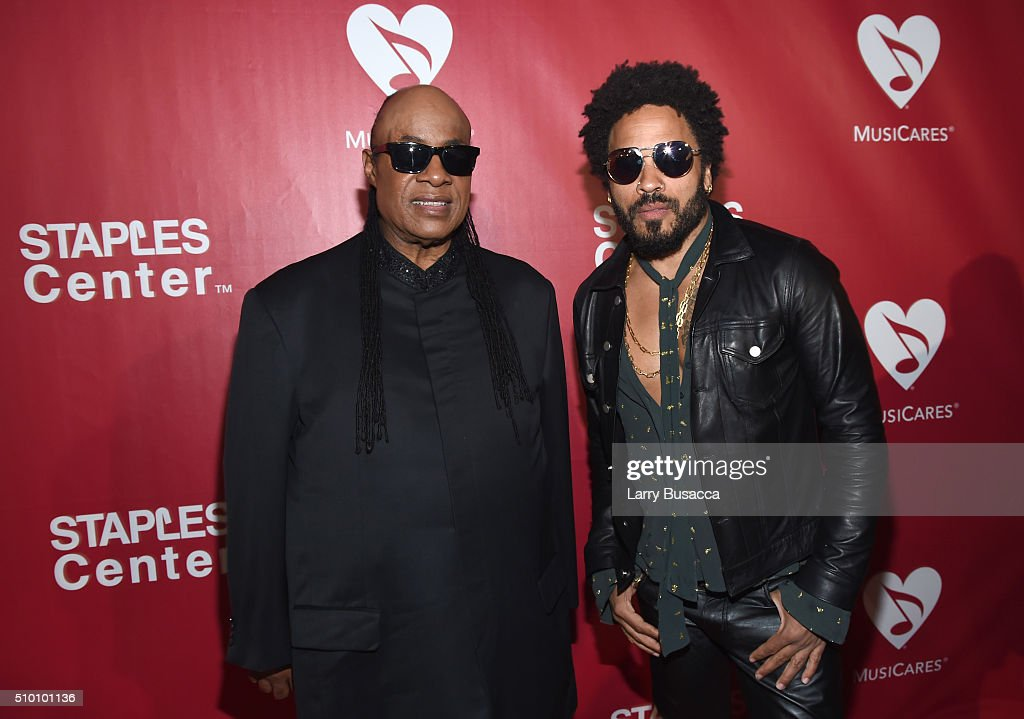 Musicians Stevie Wonder (L) and Lenny Kravitz attend the 2016 MusiCares Person of the Year honoring Lionel Richie at the Los Angeles Convention Center on February 13, 2016 in Los Angeles, California.